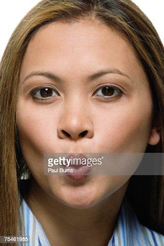 Mid adult woman pouting, portrait, close-up : Stock Photo