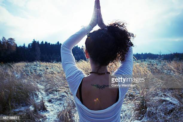 Mid adult woman practicing standing tree yoga pose