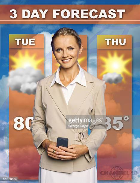 Mid adult woman presenting the weather forecast