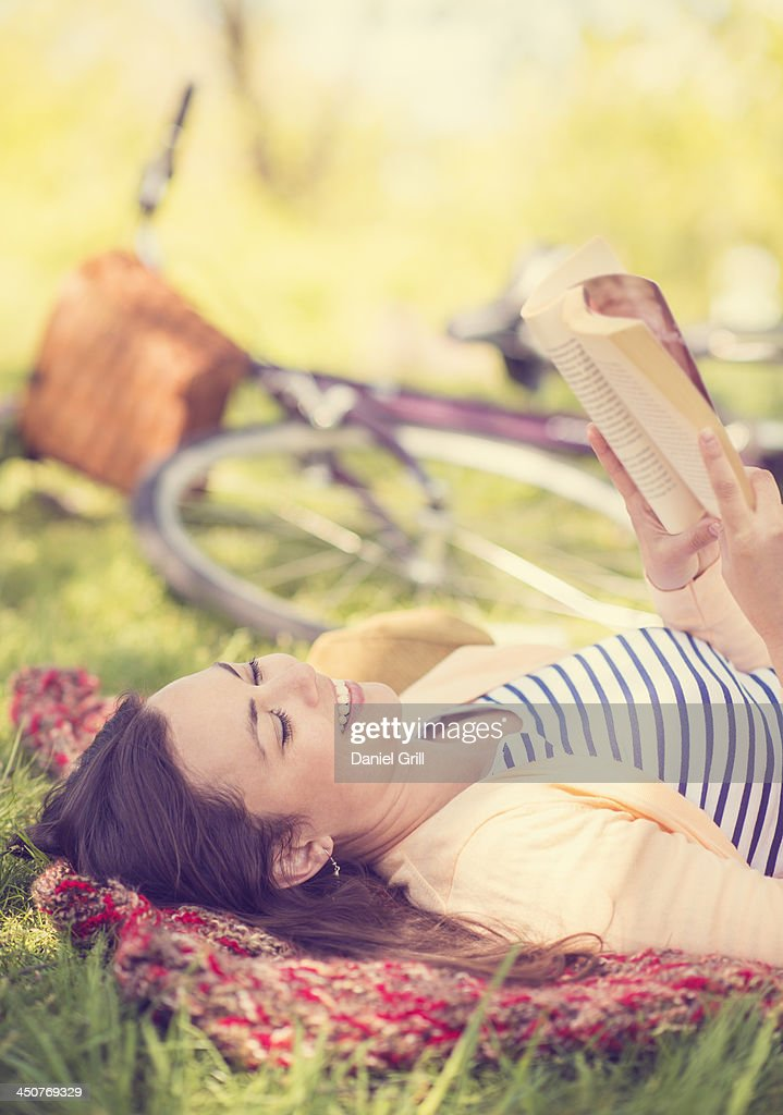Mid adult woman reading book : Stock Photo