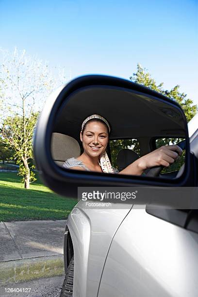 Mid Adult Woman Reflected in Side Mirror