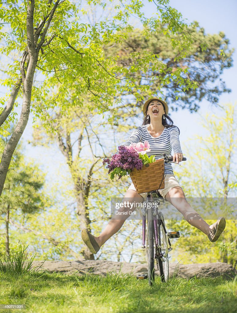 Mid adult woman riding bicycle : Stock Photo