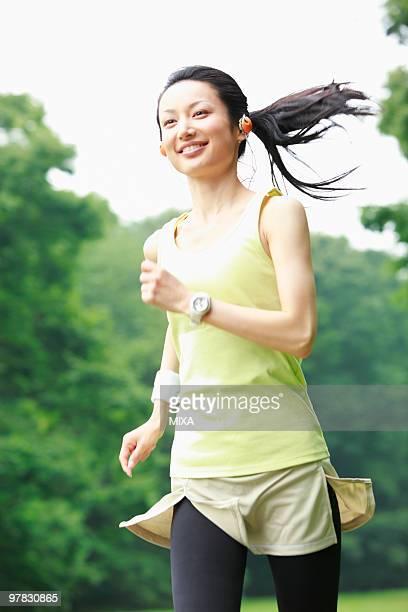 Mid adult woman running
