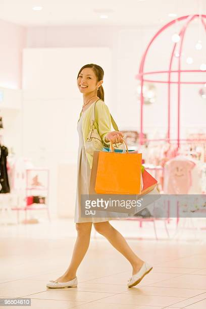 Mid Adult Woman Shopping, Holding Paper Bags