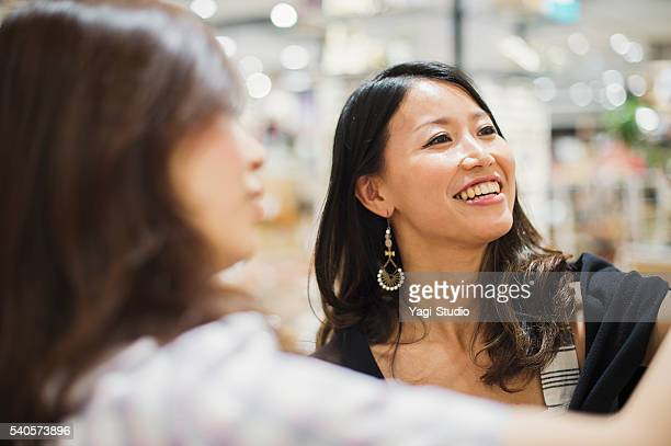 Mid Adult woman shopping in accessories shop.