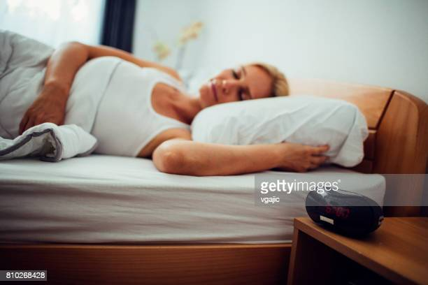 Mid adult woman sleeping