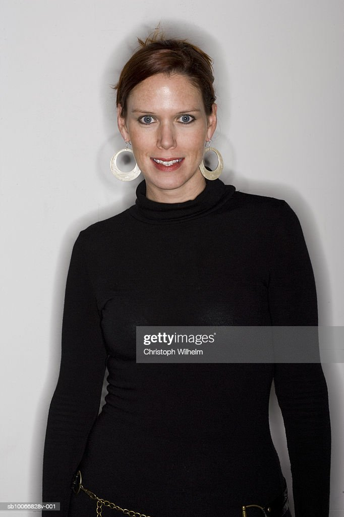 Mid adult woman, smiling, portrait, close-up : Stock Photo