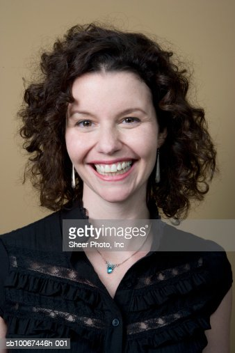 Mid adult woman smiling, portrait : Stock Photo