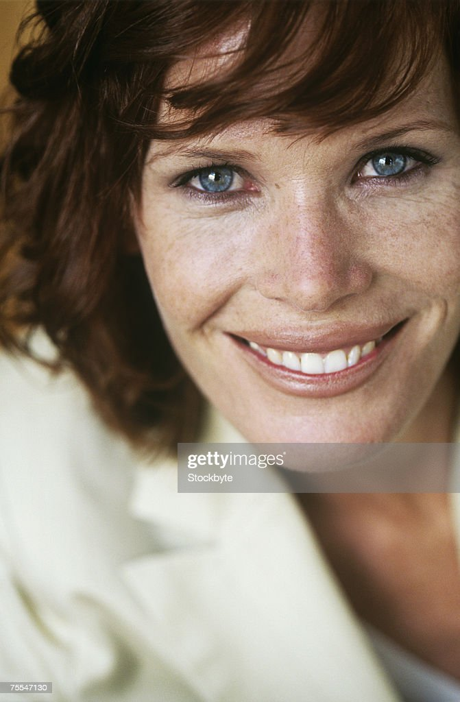 Mid adult woman smiling,portrait,close-up : Stock Photo