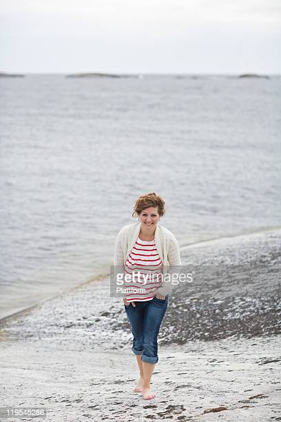 Mid adult woman standing on beach