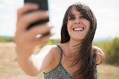 Mid adult woman taking self portrait photograph