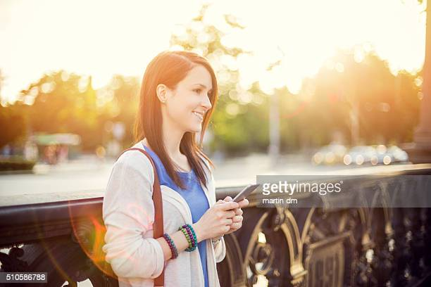 Mid adult woman using smartphone