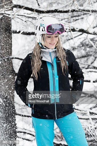 Mid adult woman wearing skiwear in snow, portrait