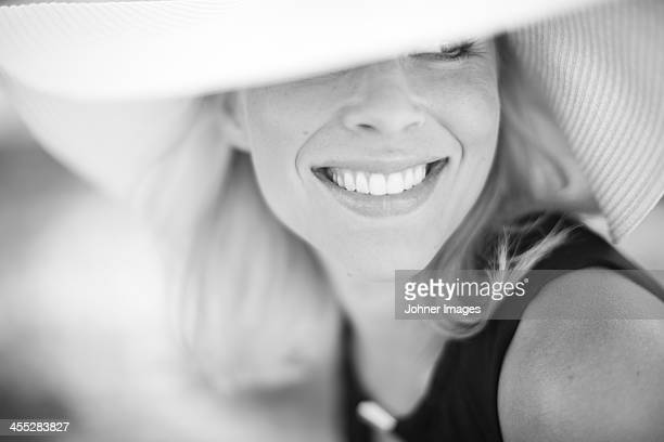 Mid adult woman wearing sun hat