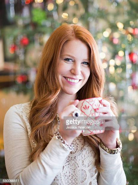 Mid adult woman with coffee mug in christmas time