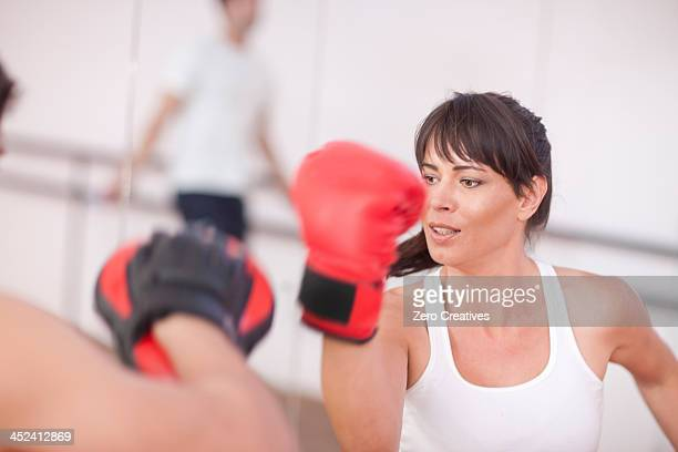 Mid adult woman with personal trainer