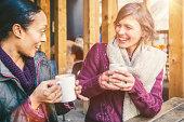 Mid Adult Women Enjoying a Warm Cup of Coffee