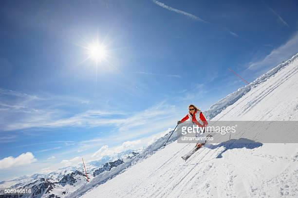 Mid adult women snow skier skiing on sunny ski resorts