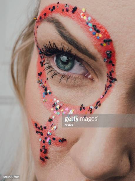Mid age woman with feminism mark on her face