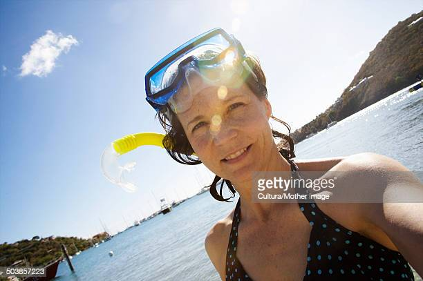 Mid Age woman with snorkeling gear