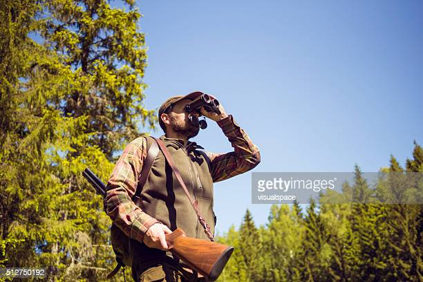 Mid Aged Man Observing The Forest Area Via Field Glasses