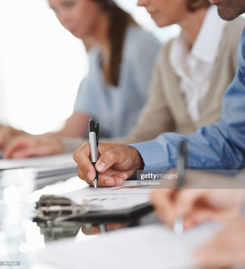Mid section of a business person making a note  : Stock Photo