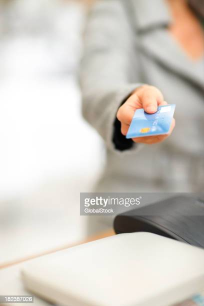 Mid section of a lady holding credit card