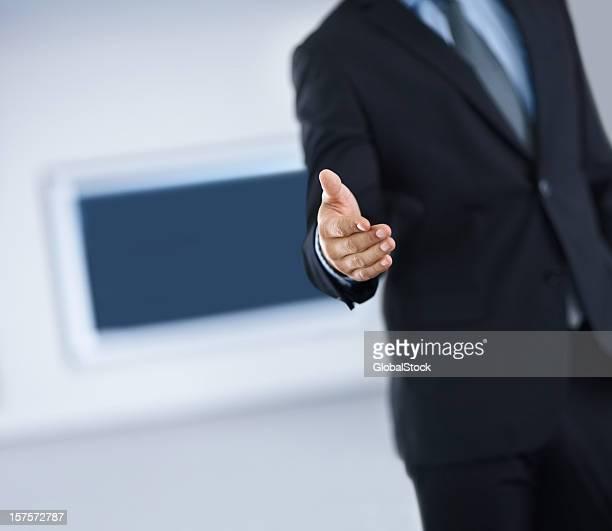 Sezione metà di Uomo d'affari con una stretta di mano