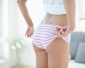 Mid section of woman wearing oversized panty