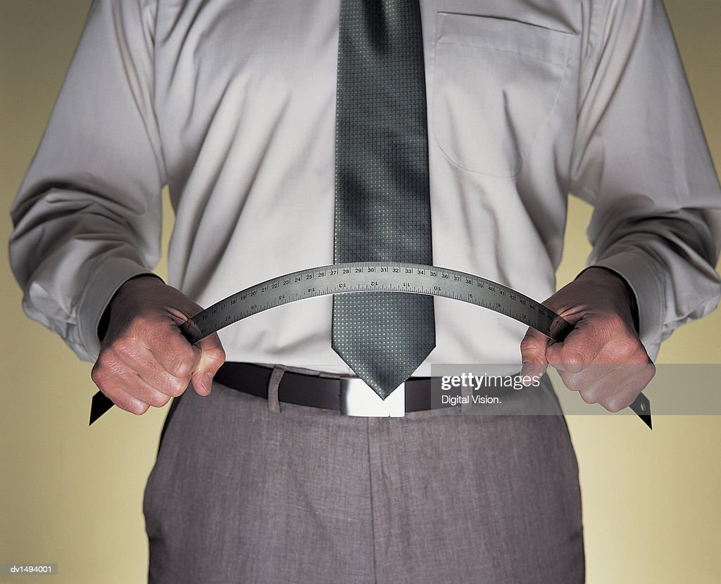 Mid Section View of a Businessman Bending a Ruler in Anger : Stock Photo