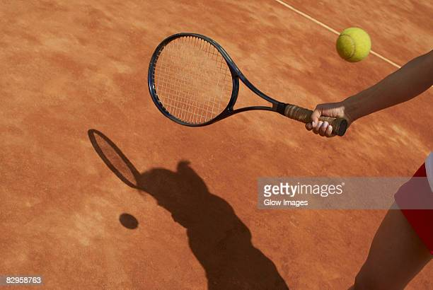 Mid section view of a female tennis player playing