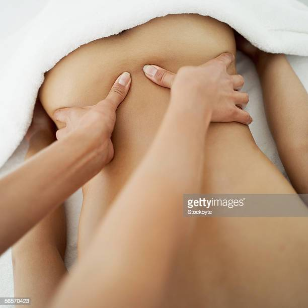 mid section view of a woman getting a back massage