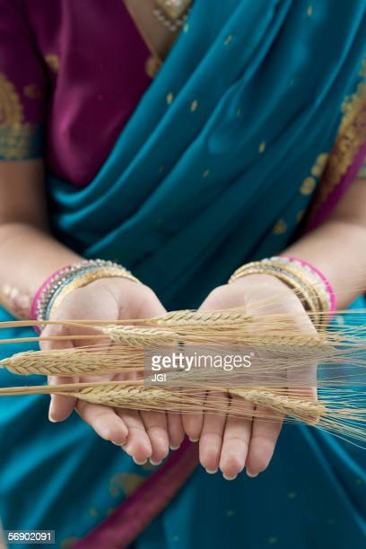 Mid section view of a woman holding husk