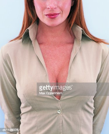 Mid Section View of a Young Businesswoman's Cleavage : Stock Photo