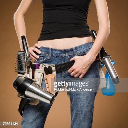 Mid Section View Of Hairdresser With Tool Belt Stock Photo ...