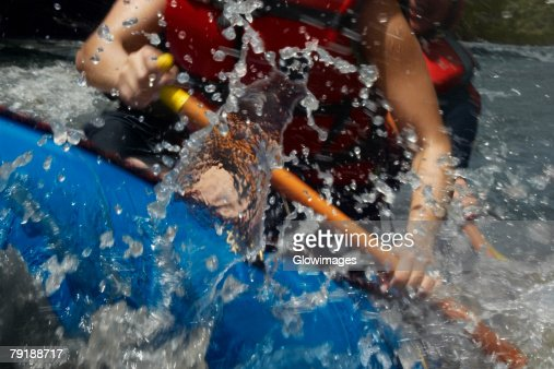 Mid section view of two people rafting in a river : Stock Photo