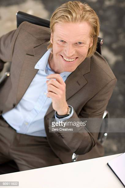 A Mid-40 Businessman sitting at a desk