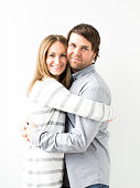 Mid-adult couple embracing