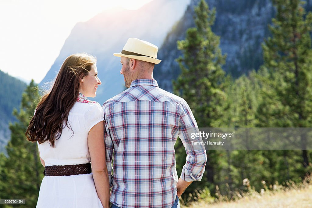 Mid-adult couple walking in mountains : ストックフォト