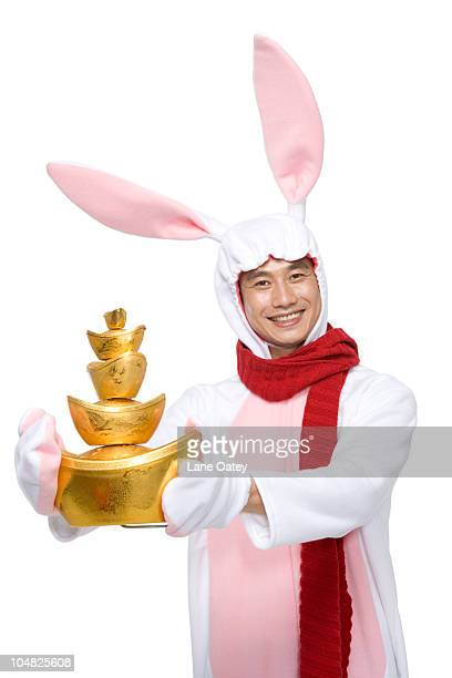 Mid-adult man celebrating the Year of the Rabbit