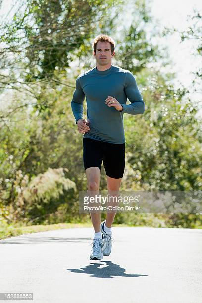 Mid-adult man jogging