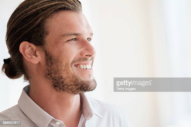 Mid-adult man laughing