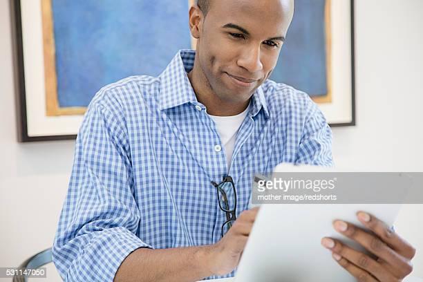 Mid-adult man shopping via internet