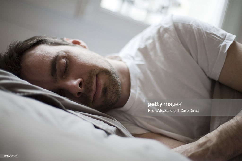 Mid-adult man sleeping