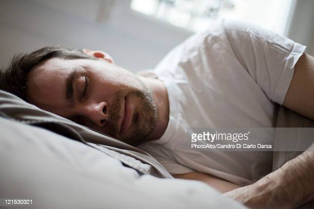 Mid-adult man sleeping