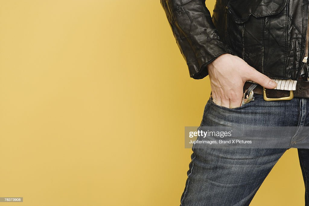 Mid-adult man with hands in pocket : Stock Photo
