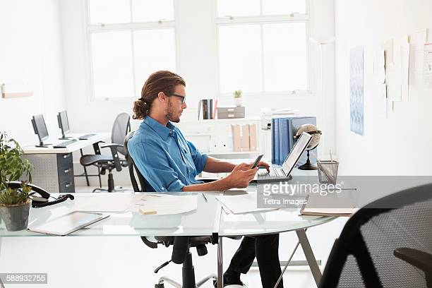 Mid-adult man working in office