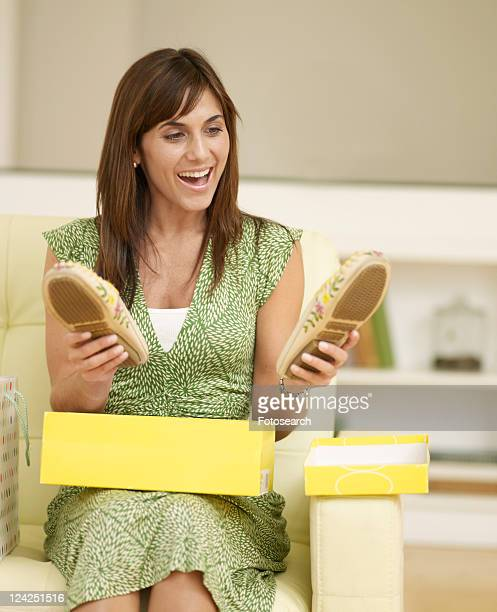 Mid-Adult Woman Admiring New Shoes