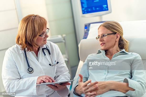 Mid-adult woman explaining her problems to her doctor