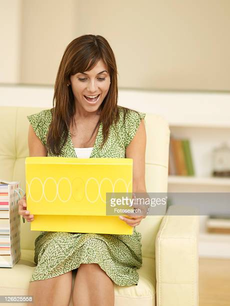 Mid-Adult Woman Opening Shoe Box